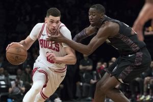 2844482b1ce Brooklyn Nets guard Caris LeVert (right) defending against Chicago Bulls  guard Zach LaVine