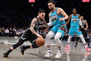 Chris Chiozza, a Brooklyn Nets two-way guard, holding off Memphis Grizzlies guard, Tyus Jones, at an NBA basketball game at the Barclays Center on Wednesday, March 4, 2020