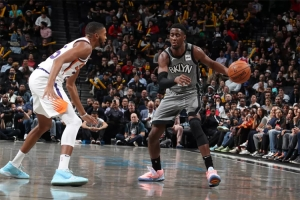 Brooklyn Nets guard Caris LeVert defending ball against Phoenix Suns forward Mikal Bridges on Monday, February 3, 2020, at the Barclays Center in Brooklyn, NY.