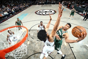Brooklyn Nets center, Jarrett Allen, defending basket against Giannis Antetokounmpo of the Milwaukee Bucks on January 18, 2020, at the Barclays Center in Brooklyn
