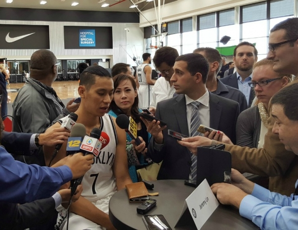 Brooklyn Nets guard Jeremy Lin talking with reporters.