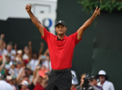 Tiger Woods, excitedly acknowledging his Tour Championship win.