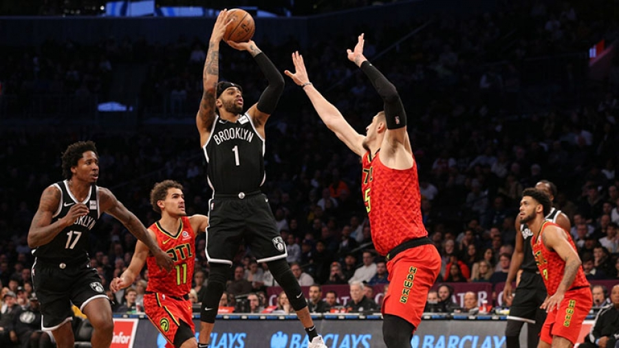 Brooklyn Nets guard D'Angelo Russell (center) shooting the ball over Alex Len (right) of the Atlanta Hawks