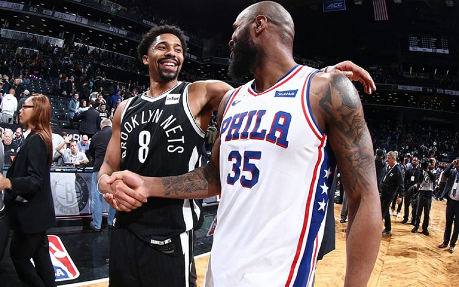 Brooklyn Nets point guard Spencer Dinwiddie shaking hands with former teammate Trevor Booker, who is now a forward with the Philadelphia 76ers.