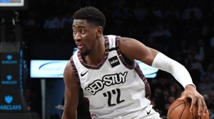 Brooklyn Nets guard, Caris LeVert, handles basketball with aplomb and scores his first triple-double in a game against the San Antonio Spurs on March 6, 2020, at the Barclays Center in Brooklyn, NY.