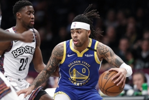 Golden State Warriors guard D'Angelo Russell (foreground) drives next to Brooklyn Nets guard Caris LeVert (22) during an NBA basketball game on Wednesday, February 5, 2020, at the Barclays Center in Brooklyn, New York. The Brooklyn Nets defeated the Golden State Warriors 129-88